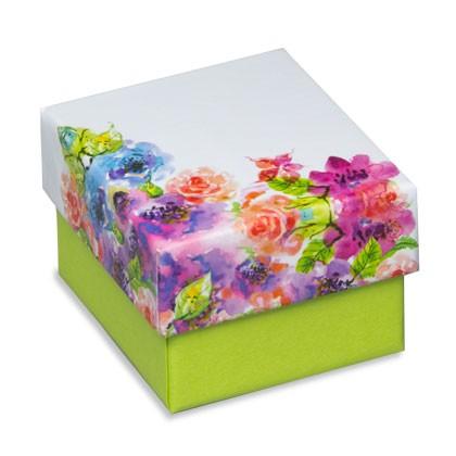 Geschenkverpackung mit fröhlichem Blumenmuster auf dem Deckel